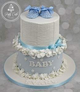 Ruffles And Ruching Baby Shoes Baby Shower Cake.