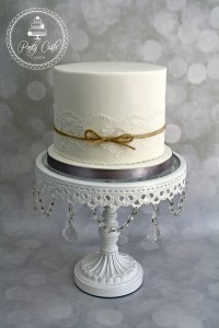 Vintage Lace Wedding Cake With Rustic Jute twine Bow.