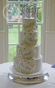 Vintage White & Silver 'And They Lived Happily Ever After' Flower Swathe 4 Tier Wedding Cake.
