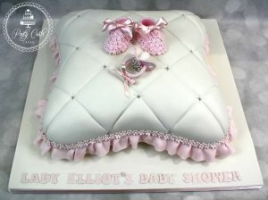 Pillow Baby Shower Cake With Flower Boottees And Crystal Dummy.