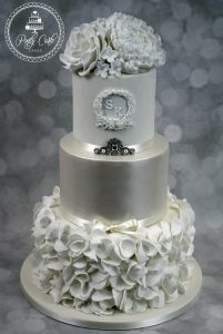 White Ruffle Monogram 3 Tier Wedding Cake With Roses And Peony.