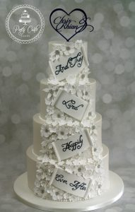 4 Tiered White Lustred 'And They Lived Happily Ever After' Floral Wedding Cake.