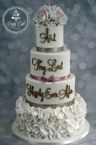 4 Tier 'And They Lived Happily Ever After' Ruffled Gold Glitter Wedding Cake.