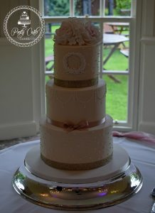 Blush,Ivory And Gold Monogram 3 Tier Wedding Cake .