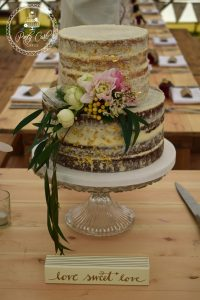Gold Leaf Trimmed Semi Naked Wedding Cake.