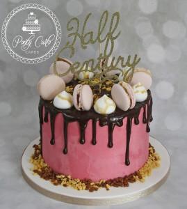 Chocolate Drip Cake With Macarons.