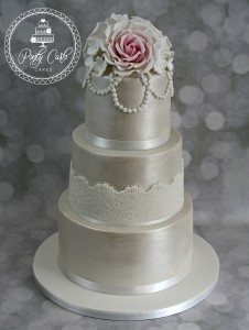 Lustred Blush Pink Rose 3 Tier Wedding cake With Pearl Swags.