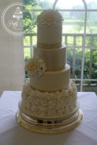 Ivory And Gold Lustred Vintage Rose Ruffled 3 Tier Wedding Cake.