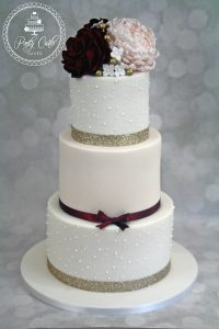 Burgundy And Nude Glittery 3 Tier Wedding Cake With Roses And Peony.