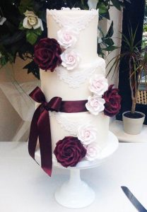 Vintage Ivory With Lace Swags And Roses Wedding Cake.